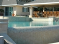 swimming pool design with infinity edge and dam wall