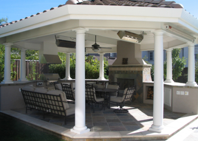 Pavilion with outdoor fireplace and outdoor BBQ kitchen